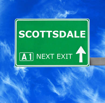scottsdale: SCOTTSDALE road sign against clear blue sky