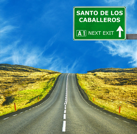 santo: SANTO DE LOS CABALLEROSroad sign against clear blue sky Stock Photo