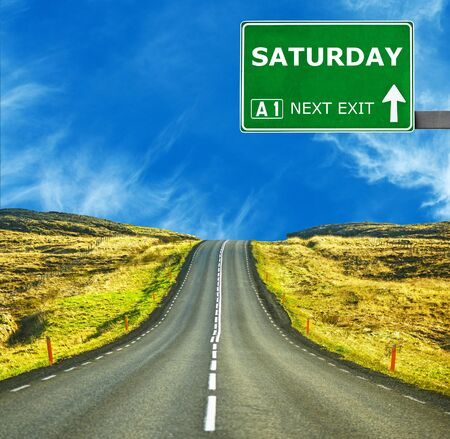 saturday: SATURDAY road sign against clear blue sky