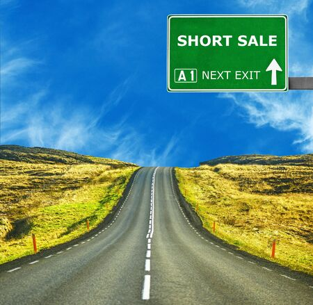 short sale: SHORT SALEroad sign against clear blue sky Stock Photo