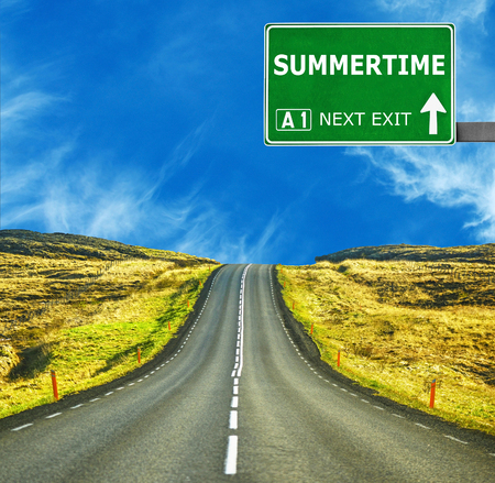 respite: SUMMERTIME road sign against clear blue sky Stock Photo