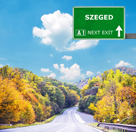 szeged: SZEGED road sign against clear blue sky Stock Photo