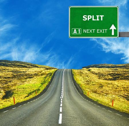 split road: SPLIT road sign against clear blue sky