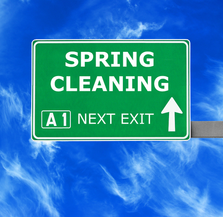 sanitizing: SPRING CLEANING road sign against clear blue sky