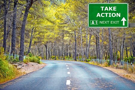 TAKE ACTION road sign against clear blue sky