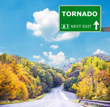 windstorm: TORNADO road sign against clear blue sky