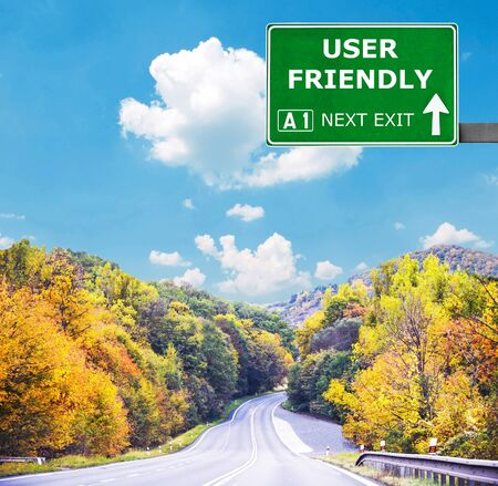 user friendly: USER FRIENDLY road sign against clear blue sky