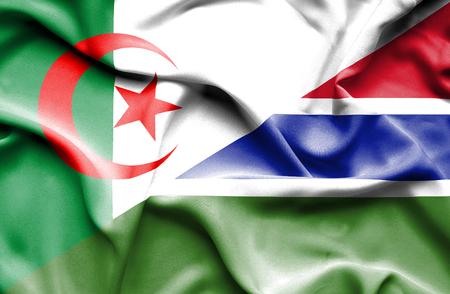 gambia: Waving flag of Gambia and Algeria Stock Photo