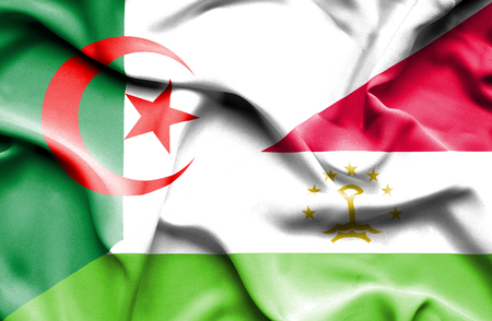 immigrant: Waving flag of Tajikistan and Algeria Stock Photo