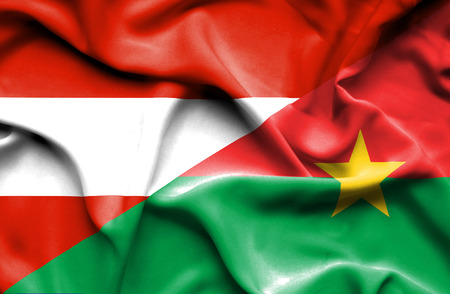burkina faso: Waving flag of Burkina Faso and Austria Stock Photo