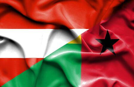 guinea bissau: Waving flag of Guinea Bissau and Austria