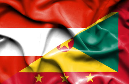 guernsey: Waving flag of Guernsey and Austria Stock Photo