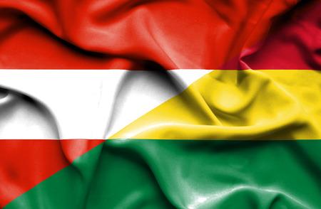 bolivia: Waving flag of Bolivia and Austria Stock Photo