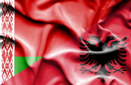 albania: Waving flag of Albania and Belarus Stock Photo