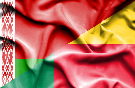 benin: Waving flag of Benin and Belarus Stock Photo