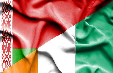 coast: Waving flag of Ivory Coast and Belarus Stock Photo