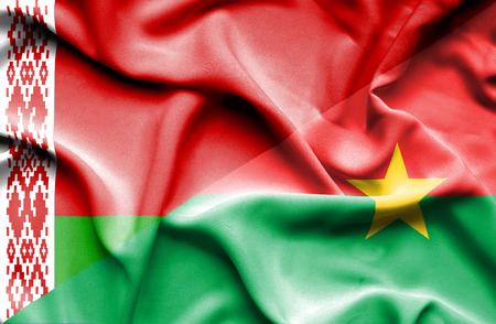 burkina faso: Waving flag of Burkina Faso and Belarus Stock Photo