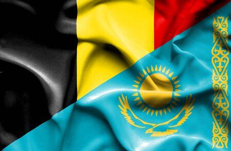 kazakhstan: Waving flag of Kazakhstan and Belgium Stock Photo