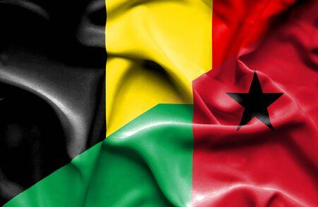 guinea bissau: Waving flag of Guinea Bissau and Belgium