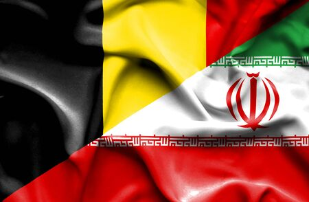 iran: Waving flag of Iran and Belgium Stock Photo