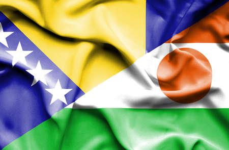bosnian: Waving flag of Niger and Bosnia and Herzegovina Stock Photo