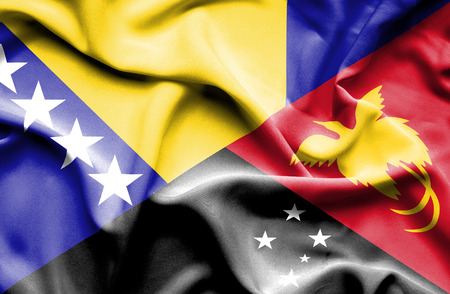 herzegovina: Waving flag of Papua New Guinea and Bosnia and Herzegovina Stock Photo