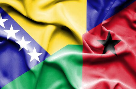 guinea bissau: Waving flag of Guinea Bissau and Bosnia and Herzegovina