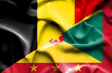 guernsey: Waving flag of Guernsey and Belgium Stock Photo