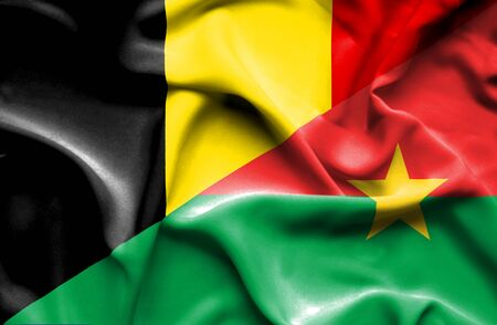 burkina faso: Waving flag of Burkina Faso and Belgium Stock Photo