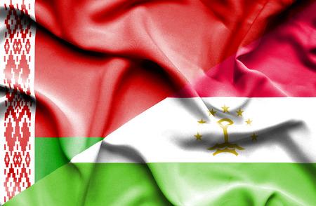 tajikistan: Waving flag of Tajikistan and Belarus Stock Photo