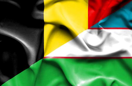uzbekistan: Waving flag of Uzbekistan and Belgium
