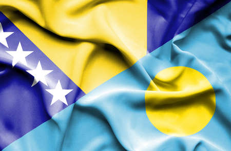bosnia: Waving flag of Palau and Bosnia and Herzegovina Stock Photo