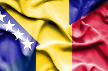 bosnian: Waving flag of Chad and Bosnia and Herzegovina Stock Photo