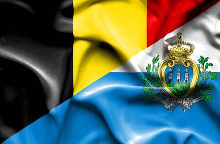 san marino: Waving flag of San Marino and Belgium Stock Photo