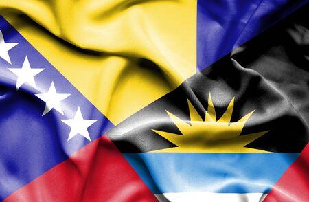 bosnian: Waving flag of Antigua and Barbuda and Bosnia and Herzegovina Stock Photo