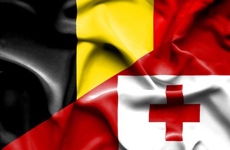 tonga: Waving flag of Tonga and Belgium Stock Photo