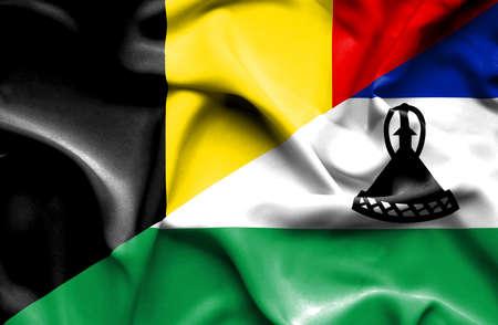 lesotho: Waving flag of Lesotho and Belgium Stock Photo