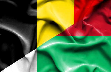 madagascar: Waving flag of Madagascar and Belgium Stock Photo