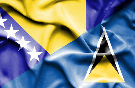 st lucia: Waving flag of St Lucia and Bosnia and Herzegovina Stock Photo