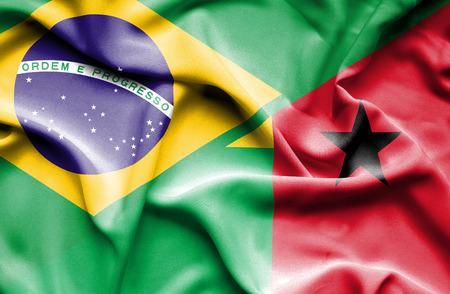 guinea bissau: Waving flag of Guinea Bissau and  Brazil