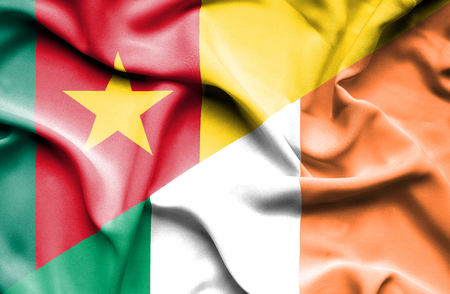 cameroon: Waving flag of Ireland and Cameroon Stock Photo