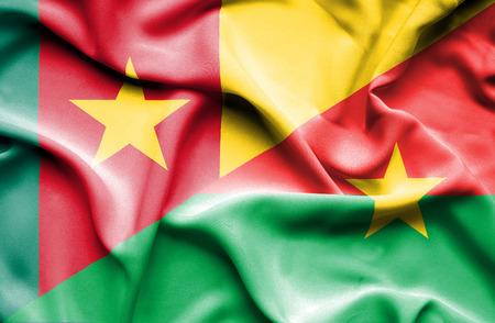 burkina faso: Waving flag of Burkina Faso and Cameroon