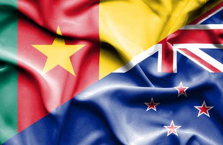 bandera de nueva zelanda: Ondeando la bandera de Nueva Zelanda y Camer�n Foto de archivo