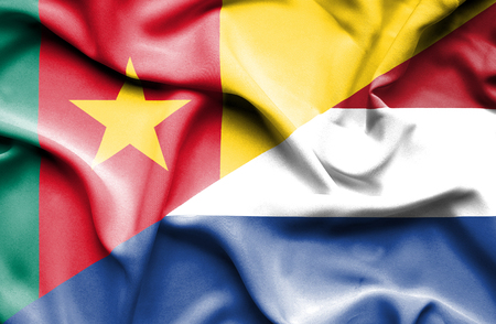 cameroon: Waving flag of Netherlands and Cameroon Stock Photo