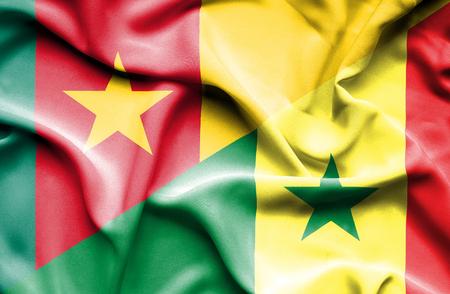 senegal: Waving flag of Senegal and Cameroon Stock Photo