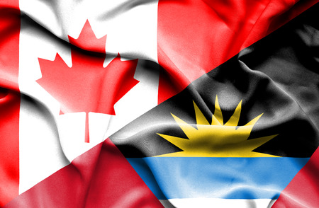 antigua: Waving flag of Antigua and Barbuda and Canada Stock Photo
