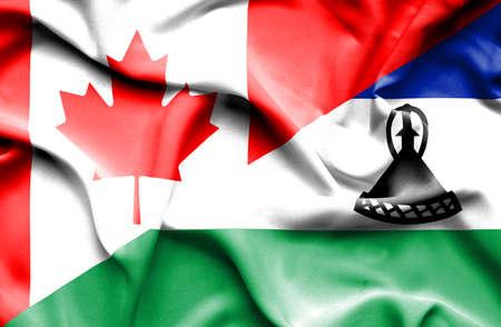 LESOTHO: Waving flag of Lesotho and Canada