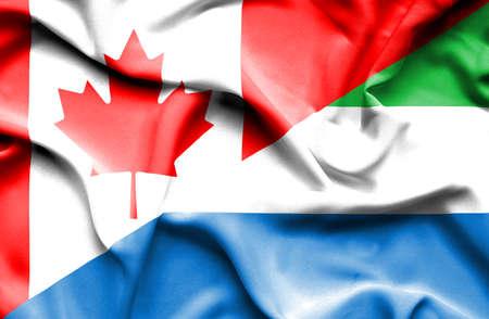 sierra leone: Waving flag of Sierra Leone and Canada