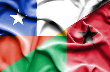 bissau: Waving flag of Guinea Bissau and Chile Stock Photo