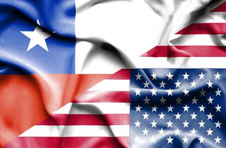 Waving flag of United States of America and Chile